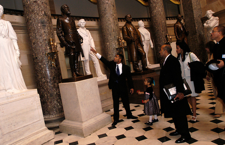 Rep. Jesse Jackson, Jr., D-Il., gives a tour to friends and supporters of Rosa Parks in Statuary Hall of the Capitol, where a statue of the civil rights leader is to be placed by 2007.