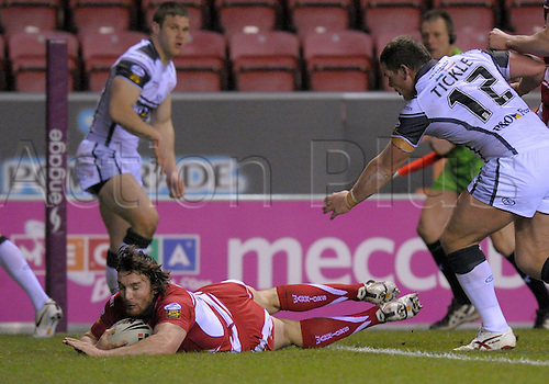 12.03.2010. Wigan, Lancashire.  2010 Rugby League Wigan v Hull Mar 12.  Martin Gleeson goes over for a score for  Wigan as Tickle and another Hull player cannot catch him. .Photo: Alan Edwards/Actionplus.