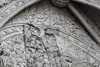 Relief of Christ on the cross, from above the tympanum of the South Portal, 1516-18, by Joao de Castilho, 1470ñ1552, after a design by Diogo de Boitaca, Church of Santa Maria, at the Jeronimos Monastery or Hieronymites Monastery, a monastery of the Order of St Jerome, built in the 16th century in Late Gothic Manueline style, Belem, Lisbon, Portugal. The portal consists of double doors with a tympanum carved with scenes from the life of St Jerome, a statue of Henry the Navigator, many carved statues in niches, a statue of the Madonna and many flamboyant pinnacles and gables in Manueline style. The monastery is listed as a UNESCO World Heritage Site. Picture by Manuel Cohen