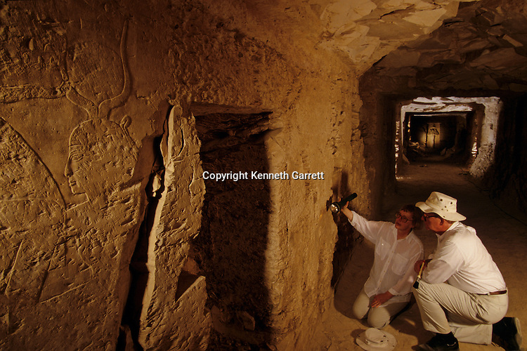 Egypt's Valley of the Kings, Kent & Susan Weeks examining 100 ft hallway lined with doors in KV5, built for sons of Ramses II