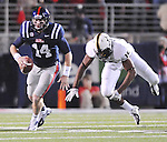 Mississippi quarterback Bo Wallace (14) is chased by Vanderbilt linebacker Archibald Barnes (15) at Vaught-Hemingway Stadium in Oxford, Miss. on Saturday, November 10, 2012. (AP Photo/Oxford Eagle, Bruce Newman)
