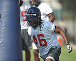 Ole Miss' (46) goes through a drill at  football practice in Oxford, Miss. on Sunday, August 7, 2011.