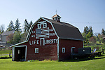 """Washington, Latah.  A patriotic painted red barn declares """"In God we Trust"""" """"Life n Liberty"""" in the small farming community of Latah."""