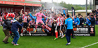 Lincoln City's Luke Waterfall lifts the Vanarama National League trophy as the Imps players celebrate<br /> <br /> Photographer Chris Vaughan/CameraSport<br /> <br /> Vanarama National League - Lincoln City v Macclesfield Town - Saturday 22nd April 2017 - Sincil Bank - Lincoln<br /> <br /> World Copyright &copy; 2017 CameraSport. All rights reserved. 43 Linden Ave. Countesthorpe. Leicester. England. LE8 5PG - Tel: +44 (0) 116 277 4147 - admin@camerasport.com - www.camerasport.com