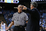 16 December 2015: Referee Louie Andrakakos (left) talks to Tulane head coach Ed Conroy. The University of North Carolina Tar Heels hosted the Tulane University Green Wave at the Dean E. Smith Center in Chapel Hill, North Carolina in a 2015-16 NCAA Division I Men's Basketball game. UNC won the game 96-72.