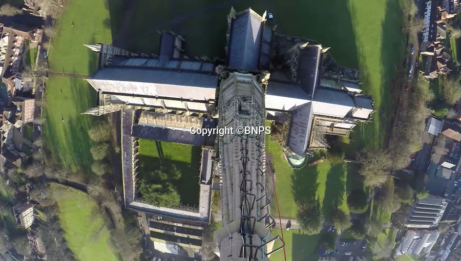 BNPS.co.uk (01202 558833)<br /> Pic: GaryPrice/BNPS.<br /> <br /> Astonishing birds eye view from the spire.<br /> <br /> Ultimate selfie - Birds eye view from the worlds tallest medieval building.<br /> <br /> This is Salisbury Cathedral Clerk of Works Gary Price's stomach-flipping view from the dizzying top of Britains tallest spire, something very few people have seen for over 750 years.<br /> <br /> Kitted out in ropes, a harness and a hard hat and accompanied by rope access specialists from Vitruvius Conservation, Gary made the hair-raising climb up the 404ft spire to replace the cathedral's faulty wind meter.