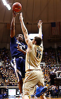 WEST LAFAYETTE, IN - DECEMBER 01: Travis Taylor #4 of the Xavier Musketeers shoots the ball over Donnie Hale #15 of the Purdue Boilermakers at Mackey Arena on December 1, 2012 in West Lafayette, Indiana. Xavier defeated Purdue 63-57. (Photo by Michael Hickey/Getty Images) *** Local Caption *** Travis Taylor; Donnie Hale