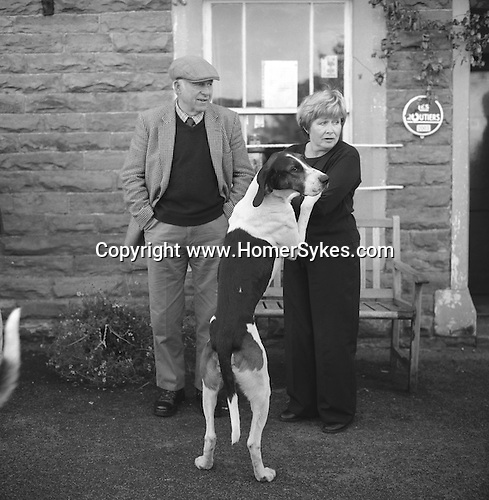The Blencathra Foxhounds. Hounds develop a strong bond with the families they go out to walk with each summer. The meet at the Old Crown. Hesket Newmarket, Cumbria. ..Hunting with Hounds / Mansion Editions (isbn 0-9542233-1-4) copyright Homer Sykes. +44 (0) 20-8542-7083. < www.mansioneditions.com >