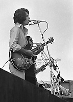 Bob Weir singing and playing Guitar and Donna Godchaux singing with The Grateful Dead at Dillon Stadium in Hartford CT on 31 July 1974. Close in sidelong shot. Photo by Michael Thut, Fairfield CT.
