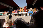 Lace shops and brightly coloured buildings, on the island of Burano, Venice famous for lace production. Venice, Italy.