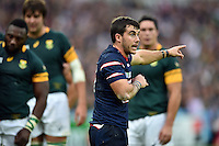 Niku Kruger of the USA speaks to his team-mates during a break in play. Rugby World Cup Pool B match between South Africa and the USA on October 7, 2015 at The Stadium, Queen Elizabeth Olympic Park in London, England. Photo by: Patrick Khachfe / Onside Images