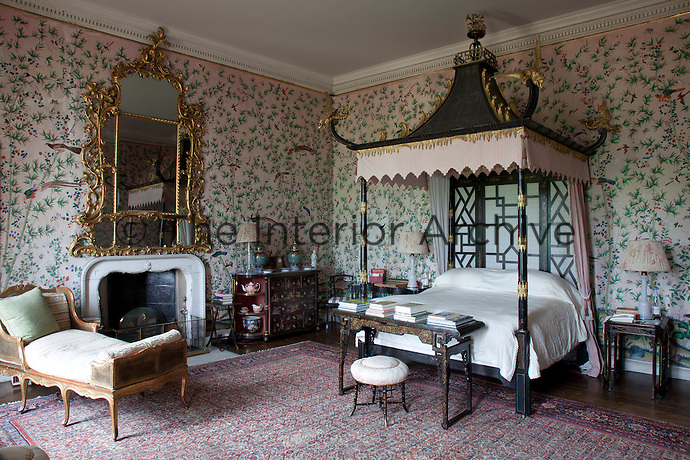 A perfect example of an 18th century chinoiserie bedroom, complete with hand painted wallpaper. The furniture are copies of Chinese furniture by William and John Linnell