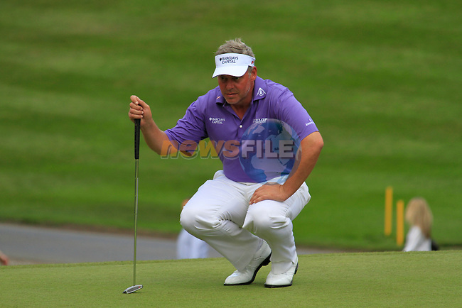 Darren Clarke lines up his putt on the 2nd green during Round 2 of the BMW PGA Championship at  Wentworth, Surrey, England...Photo Golffile/Eoin Clarke.(Photo credit should read Eoin Clarke www.golffile.ie)....This Picture has been sent you under the condtions enclosed by:.Newsfile Ltd..The Studio,.Millmount Abbey,.Drogheda,.Co Meath..Ireland..Tel: +353(0)41-9871240.Fax: +353(0)41-9871260.GSM: +353(0)86-2500958.email: pictures@newsfile.ie.www.newsfile.ie.