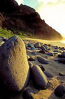Large pohaku (rock or stone in Hawaiian) on pristine Kalalau beach on the remote Na Pali coastline of Kauai.