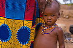 The bloated stomach, thin arms, and red/orange hair of this Fulani child in the small village of Bele Kwara in southwestern Niger indicate malnutrition and intestinal worms.  Of every 1,000 live births in Niger, 256 children die before reaching the age of 5 due to malnutrition and other diseases.  In fact, Niger ranks 174th of 177 countries on the United Nations Development Program's Human Development Index.