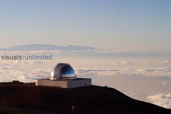 NASA Infrared Telescope Facility or IRTF of Mauna Kea Observatories, and silhouette of Haleakala of Maui at distance, Big Island, Hawaii.