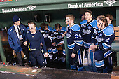 Members of the Black Bears gathered in the home dugout as preparations were made to resume the game. - The University of Maine Black Bears defeated the Boston University Terriers 7-3 (2EN) on Saturday, January 11, 2014, at Fenway Park in Boston, Massachusetts.
