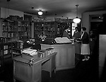 Pittsburgh PA: Students checking-out books at the Duquesne University library - 1932