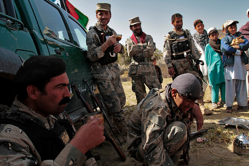 Members of the Afghan border police do a joint patrol with members of 3rd Platoon, Comanche Company 1st of the 501st. Parachute Infantry Regiment out of Fort Richardson Alaska. A biometrics sweep was conducted on the village of Taroba in Terazayi district of Khost.