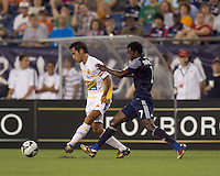 Monarcas Morelia defender Adrian Aldrete (16) passes the ball as New England Revolution forward Kenny Mansally (7) pressures. The New England Revolution defeated Monarcas Morelia in SuperLiga 2010 group stage match, 1-0, at Gillette Stadium on July 20, 2010.