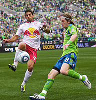 New York Red Bulls defender n44\, left, and Seattle Sounders FC midfielder Erik Friberg  try to make a play on the ball during play\ at Qwest Field in Seattle Saturday June 23, 2011. The Sounders won the game 4-2.