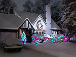 Family house decorated with Christmas lights for holidays and covered with snow nighttime scenic. Toronto, Ontario, Canada.