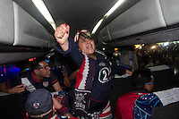 USA fans celebrate on their bus after being escorted by Mexican police officers in riot gear from the stadium.  The USA tied Mexico at their World Cup Qualifier at Azteca stadium in Mexico City, Mexico on March 26, 2013.