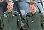 Prince William and Prince Harry and their Instructor at a photocall at RAF Shawbury Defence Helicopter Flying School.18th June 2009..