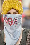 A masked Occupy LA protester..Hundreds of protesters from Occupy LA and several other organizations, held a rally and march in downtown L.A.'s financial center. .The march ended at the Bank of America building where several protesters were arrested for trespassing..Today is a 'National Day of Action,' and many cities around the U.S. held similar types of rallies and marches.