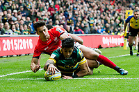 Ken Pisi of Northampton Saints reaches for the try-line despite being tackled by Alex Lozowski of Saracens. Aviva Premiership match, between Northampton Saints and Saracens on April 16, 2017 at Stadium mk in Milton Keynes, England. Photo by: Patrick Khachfe / JMP