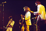 Eric Clapton 1973 at the Rainbow Concert with Ron Wood and Pete Townshend<br /> &copy; Chris Walter
