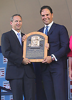NEW YORK, NY - July 24: Jeff Idelson, President of the Baseball Hall Of Fame presents  Mike Piazza with his plaque during his  induction into the Baseball Hall of Fame on July 24, 2016 in Cooperstown, New York. Photo Credit:John Palmer/ Media Punch