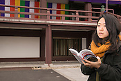 A young Japanese lady at Zojo-ji Temple, Tokyo.
