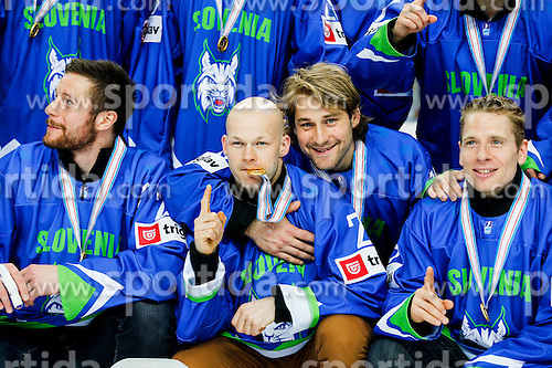 Jan Urbas, Andrej Hebar, Robert Kristan Ales Music of Slovenia celebrate after the ice hockey match between National Teams of Austria and Slovenia in 5th Round of 2016 IIHF Ice Hockey World Championship Division 1 - Group A, on April 29, 2016 in Spodek Arena, Katowice, Poland. Photo by Marek Piuyzs / Sportida