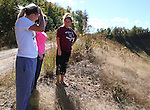 Mrs. Lewis, Madyson and her friend stand on the reclaimed of what used to be a strip mine on Friday Oct 11. 2013. There isn't a lot to do around Hyden so it's not unusual for Mrs. Lewis and company to explore this area and have picnics. <br /> Photo by Coty Giannelli