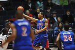 SMU's London Giles (11) has his shot blocked by Ole Miss' Reginald Buckner (23) at the C.M. &quot;Tad&quot; Smith Coliseum in Oxford, Miss. on Tuesday, January 3, 2012. Ole Miss won 50-48.