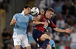 Calcio, Serie A: Lazio vs Genoa. Roma, stadio Olimpico, 23 settembre 2012..Lazio midfielder Hernanes, of Brazil, left, and Genoa defender Michele Canini jump for the ball during the Italian Serie A football match between Lazio and Genoa at Rome's Olympic stadium, 23 September 2012..UPDATE IMAGES PRESS/Riccardo De Luca