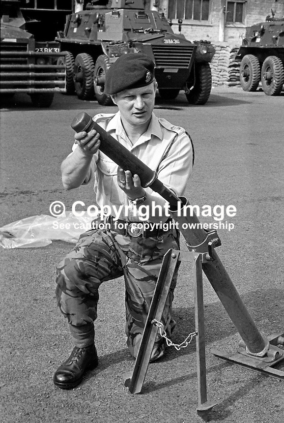 Colonel Malcolm Mackenzie-Orr, RAOC, Royal Army Ordnance Corps, demonstrating a Provisional IRA DIY rocket launcher captured in a planned search in Belfast, N Ireland, UK. The weapon was constructed from lavatory pipes and joints as used by plumbers. A few months later Mackenzie-Orr defused a massive van bomb beside a Belfast telephone exchange for which he was awarded the George Cross. After he had foiled the attempt to destroy the exchange, it was feared he might become a terrorist target and he was re-assigned to the weapons research establishment in Woomera, South Australia. He left the military having achieved the rank of brigadier. He died 16th December 2007 in Australia. 197307050472a.<br />