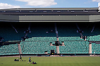 Ground staff mowing the grass in Centre Court at Wimbledon, The All England Lawn Tennis Club (AELTC), London...