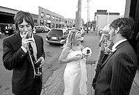 Sarah and David have a glass of wine with friends outside Pravda Studio in Seattle following their wedding ceremony there.(Photo by Scott Eklund/Red Box Pictures)