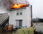 Manasquan firefighters wade through nearly waist deep water as they arrive at a house fire at an unoccupied home on Brielle Road just after 8 am as Hurricane Irene hits the Jersey Shore.   (8/28/2011)  Andrew Mills/The Star-Ledger