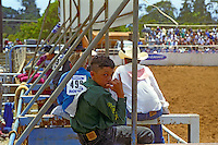A boy gives the shaka sign at the annual Fourth of July Makawao Rodeo. Hawaii's largest rodeo, it is held in the upcountry town of Makawao. Maui's cowboy or paniolo town got its start in the early 1800s as a support community for the upcountry cattle ranches.