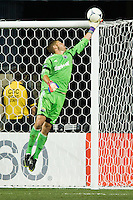 Columbus Crew goalkeeper Matt Lampson (28) pushes a ball over the bar. The Columbus Crew defeated the Philadelphia Union 2-1 during a Major League Soccer (MLS) match at PPL Park in Chester, PA, on August 29, 2012.