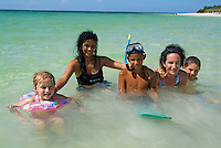 Cuban and European family bathing together, Cayo Jutias, Cuba.
