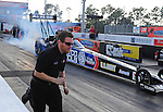Jan. 17, 2012; Jupiter, FL, USA: A crew member runs alongside the car of NHRA top fuel dragster driver Antron Brown during testing at the PRO Winter Warmup at Palm Beach International Raceway. Mandatory Credit: Mark J. Rebilas-