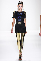 Model walks runway an EBONY SILK JERSEY T-SHIRT W/ SAPPHIRE +GOLD &amp;ADED &quot;MAKE LOVE NOT WAR&quot; by Zang Toi, for the Zang Toi Spring 2012 My Dream Of North Africa Collection, during Mercedes-Benz Fashion Week Spring 2012.