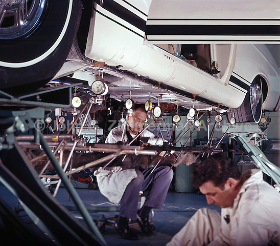 Ford test engineers take readings on a Mustang chassis to detect metal fatigue. Ford Motor Company, Dearborn Michigan, 1966. Photo by John G. Zimmerman.