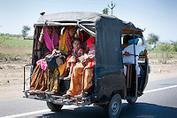 Family on the move on Delhi to Mumbai National Highway 8 at Jaipur, Rajasthan, Northern India
