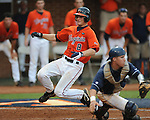 Virginia's John Hicks (8) scores behind Mississippi's Miles Hamblin (24) in the fourth during an NCAA Regional game at Davenport Field in Charlottesville, Va. on Saturday, June 5, 2010.