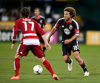 Nick DeLeon (18) of D.C. United carries the ball past Zach Loyd (17) of FC Dallas  at RFK Stadium in Washington DC.   Dallas FC fell to D.C. United, 4-1.